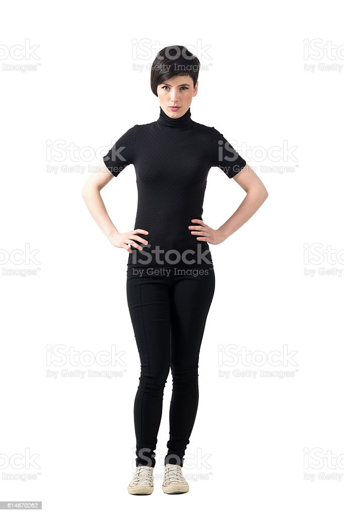 Serious bossy short hair pretty woman with hands on hips stock photo