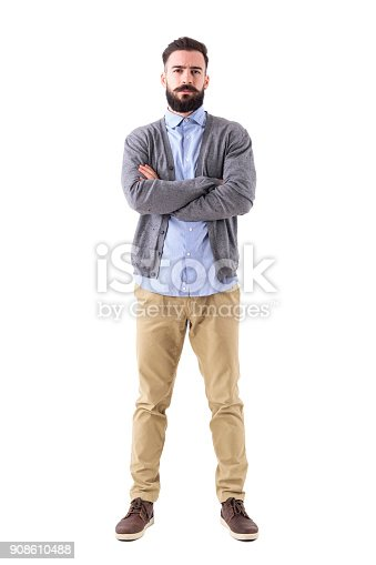 istock Serious bossy teacher or businessman with crossed arms looking at camera 908610488