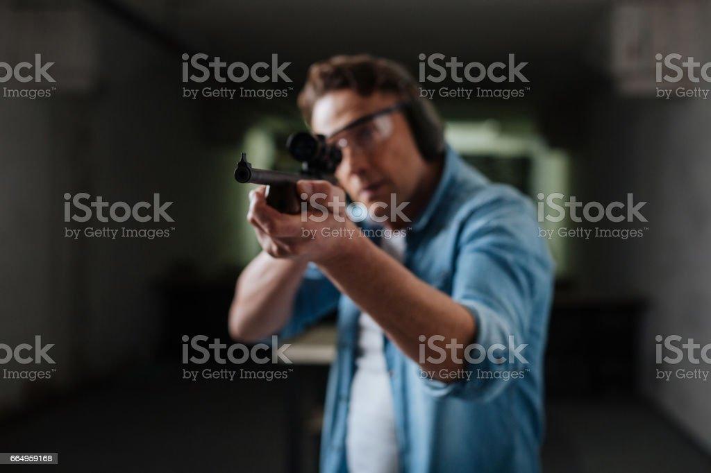 Serious brutal man hitting the target stock photo