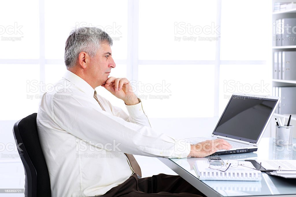 Serious business man at workplace. royalty-free stock photo