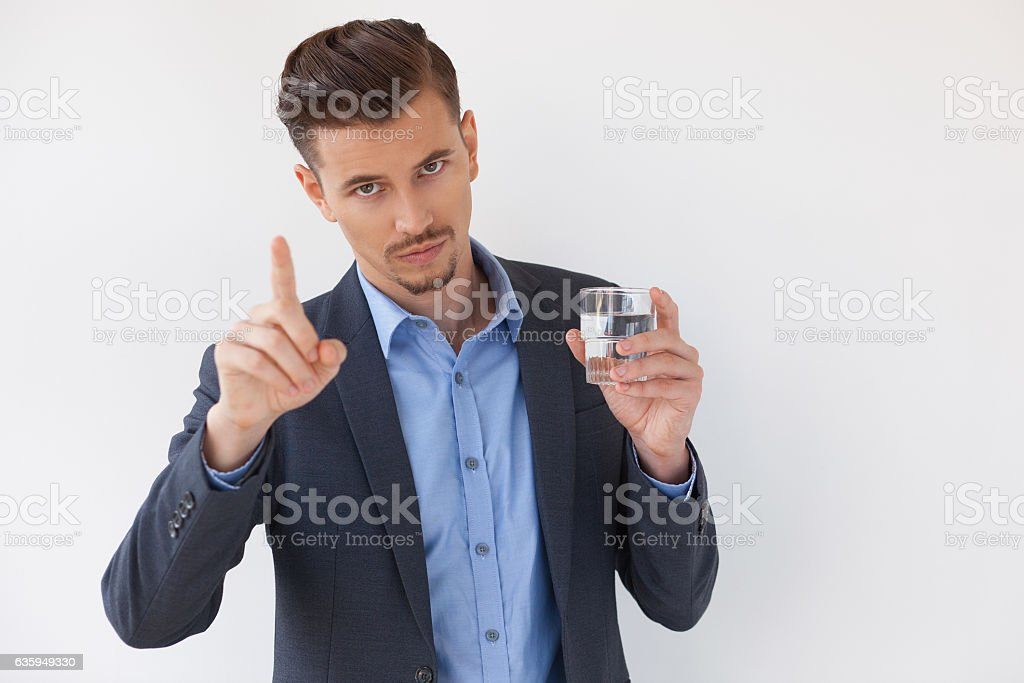 Serious Business Man Showing Warning Gesture stock photo