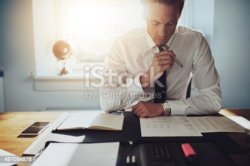 istock Serious business man working on documents 497094878
