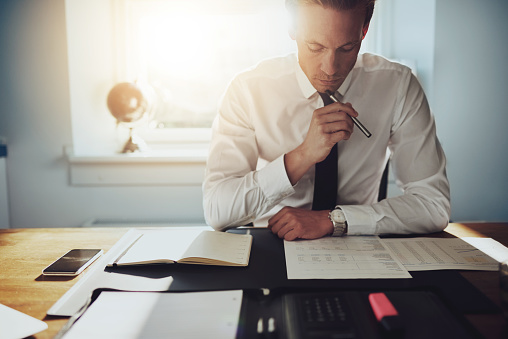 Serious Business Man Working On Documents Stock Photo - Download Image Now