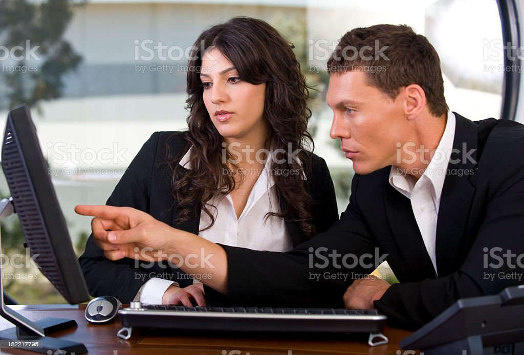 Serious business team working together royalty-free stock photo
