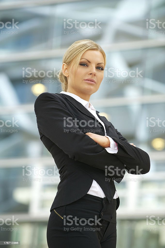 Serious business woman standing outdoors royalty-free stock photo