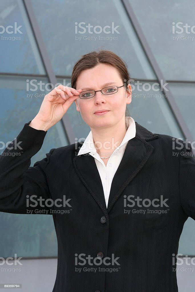 serious business woman with glasses royalty free stockfoto
