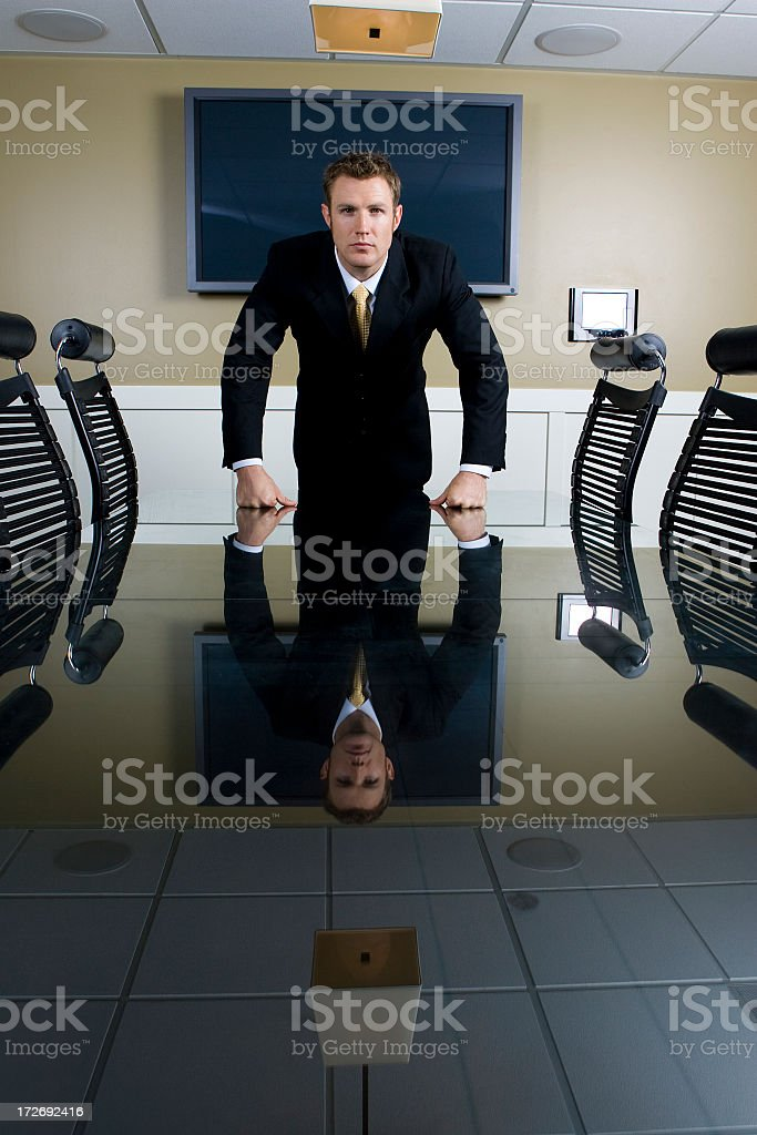 Serious Businessman at Conference Table royalty-free stock photo