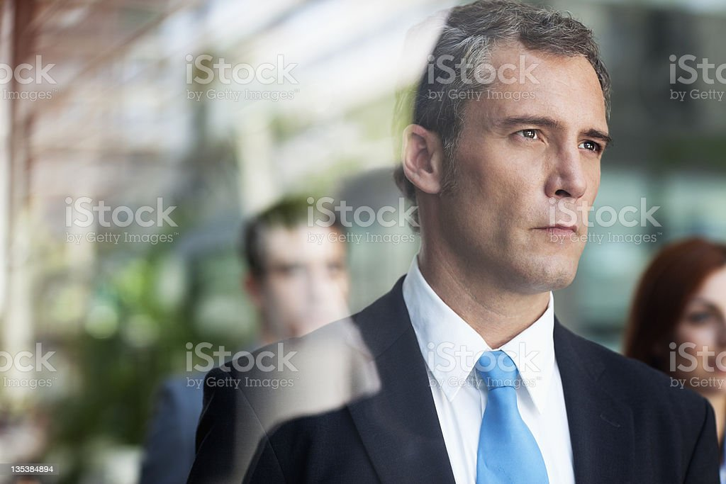 Serious businessman looking out window royalty-free stock photo