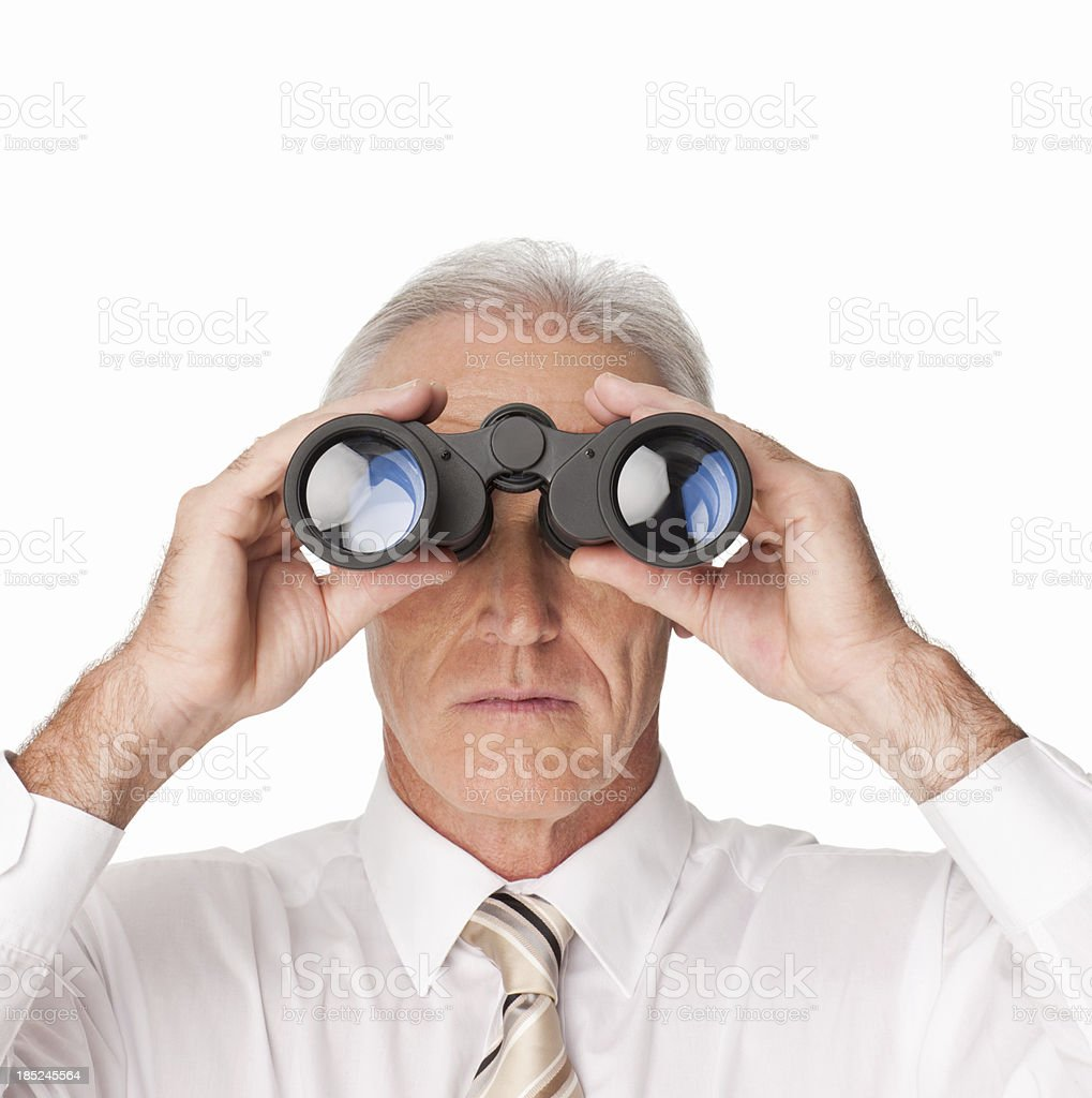 Serious Businessman Looking Through Binoculars - Isolated royalty-free stock photo