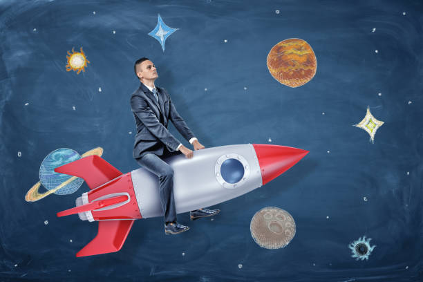 a serious businessman rides a silver and red rocket among the drawings of planets and stars - исследование космоса стоковые фото и изображения