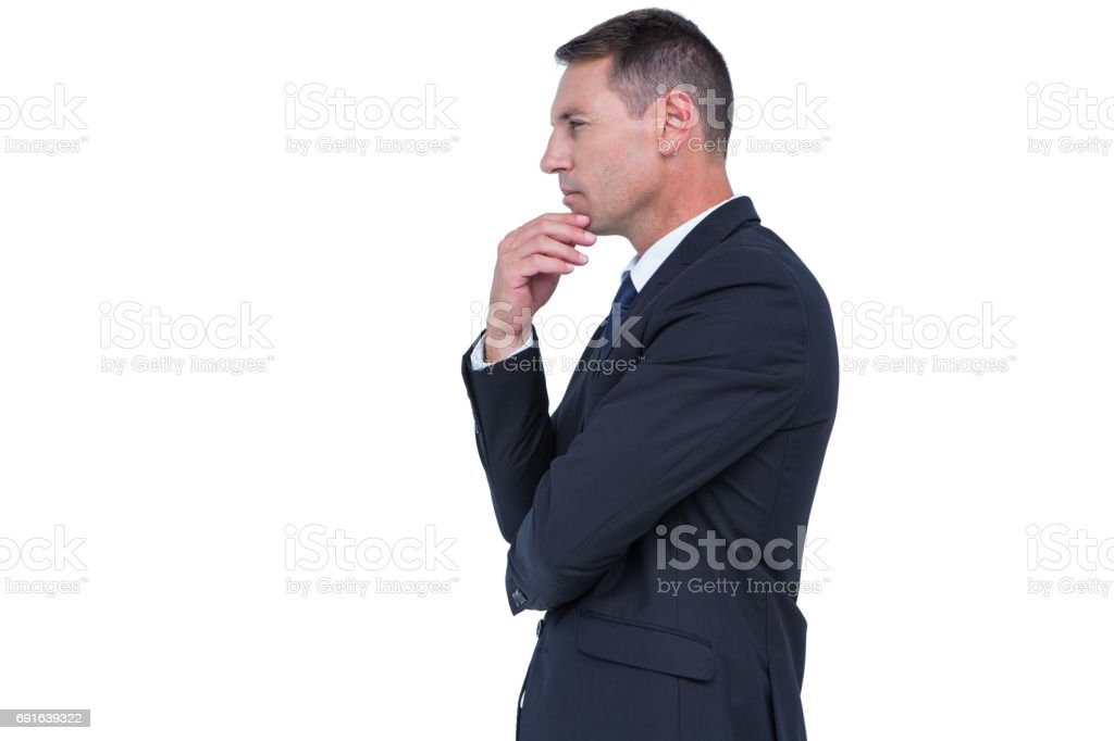 Serious businessman thinking with hand on chin stock photo