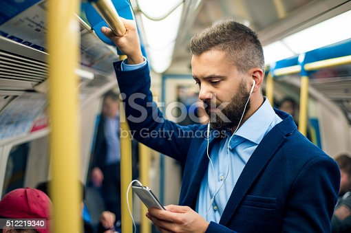 istock Serious businessman travelling to work. Standing inside undergro 512219340