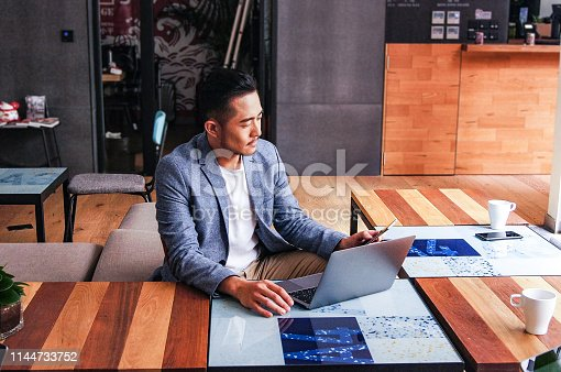 Asian businessman working alone sitting in a coworking space