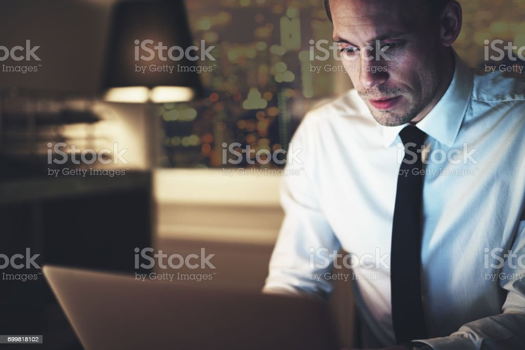 Serious businessman working on laptop stock photo