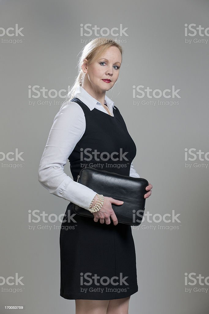 serious businesswoman holding briefcase stock photo