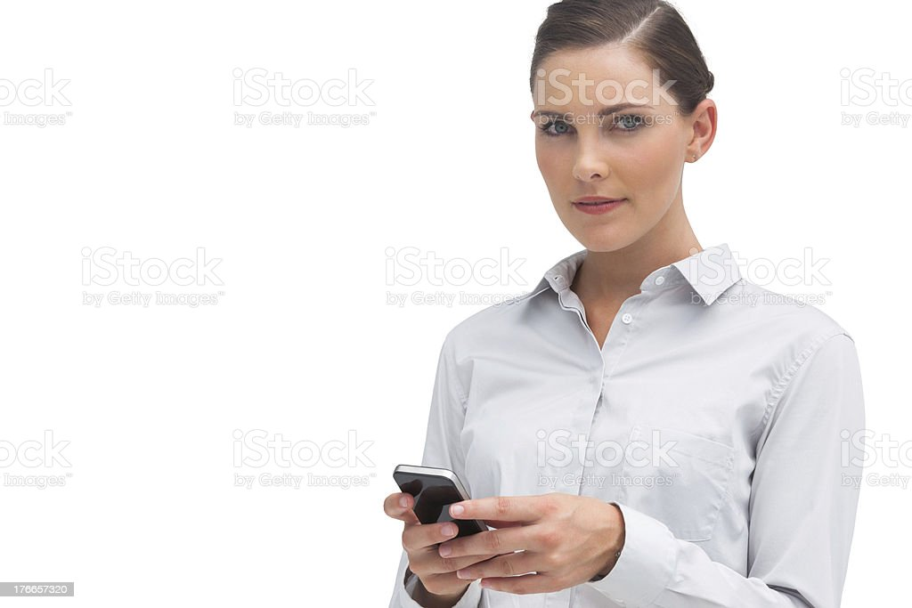 Serious businesswoman holding cellphone royalty-free stock photo