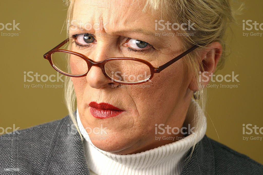 Serious Businesswoman Making Concerned Facial Expression royalty-free stock photo