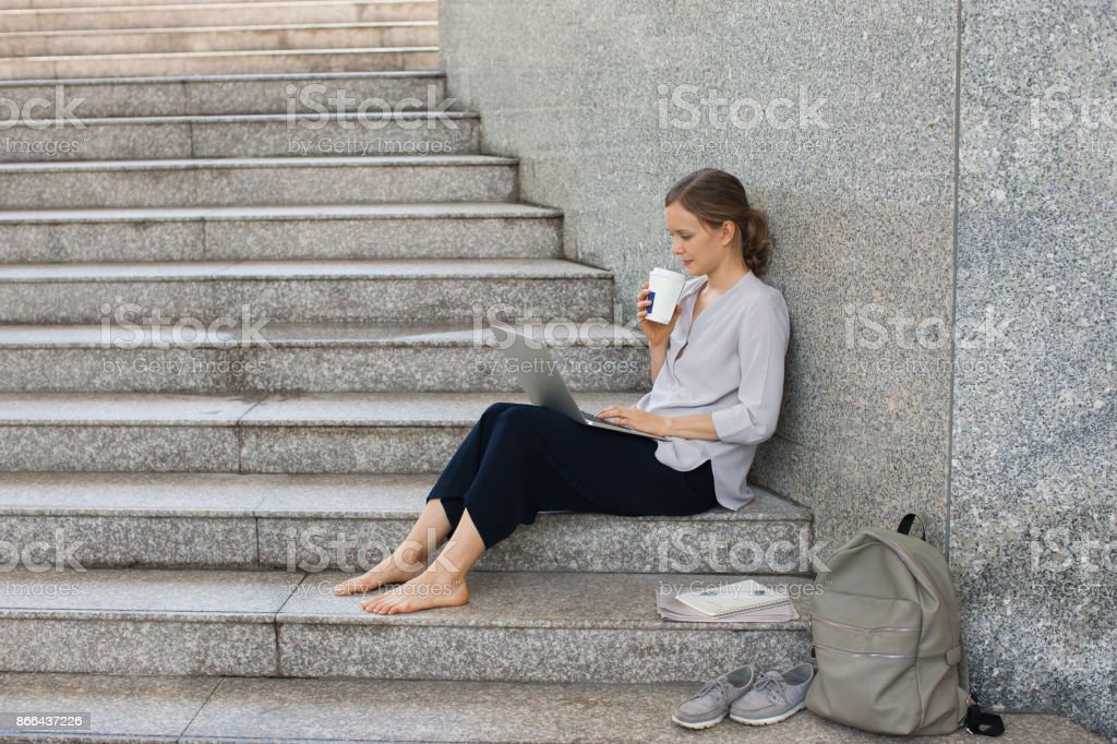 Serious businesswoman or student working on stairs стоковое фото