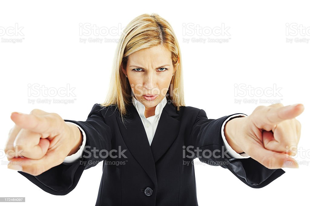 Serious Businesswoman Pointing with Both Hands royalty-free stock photo