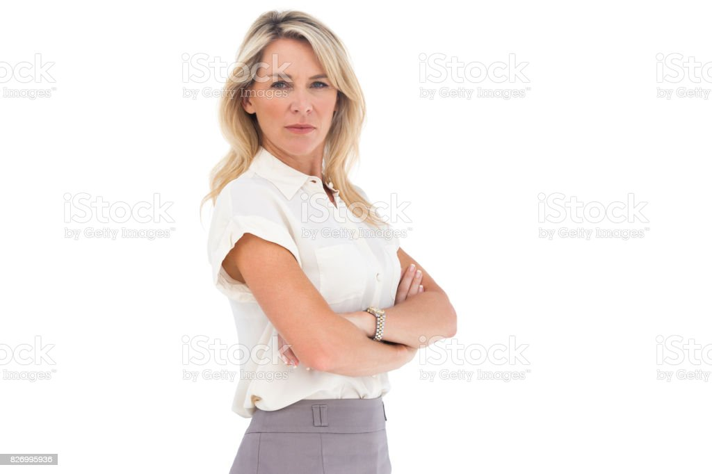 Serious businesswoman standing with arms crossed - foto stock