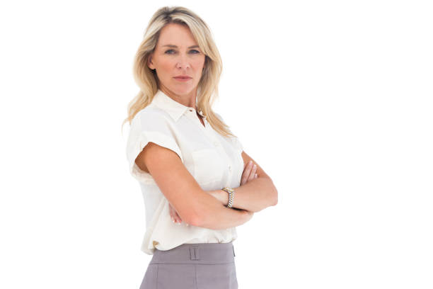Serious businesswoman standing with arms crossed stock photo