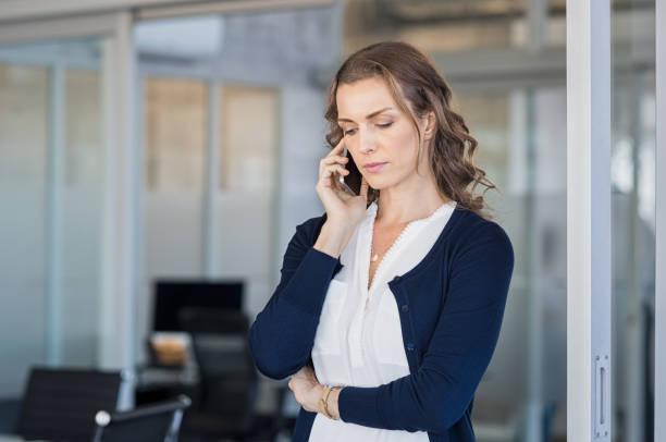 Serious businesswoman talking on phone stock photo