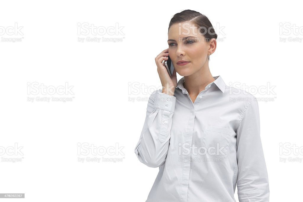 Serious businesswoman with cellphone royalty-free stock photo