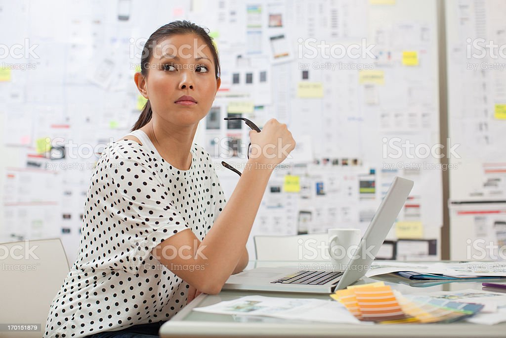 Serious businesswoman with laptop in office royalty-free stock photo