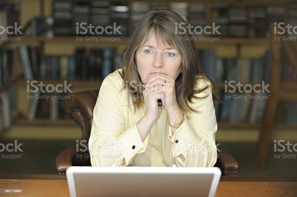 Serious businesswoman with laptop stock photo