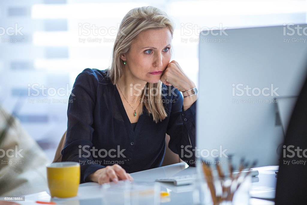 Serious businesswoman working at computer in office - Royalty-free 35-39 Years Stock Photo
