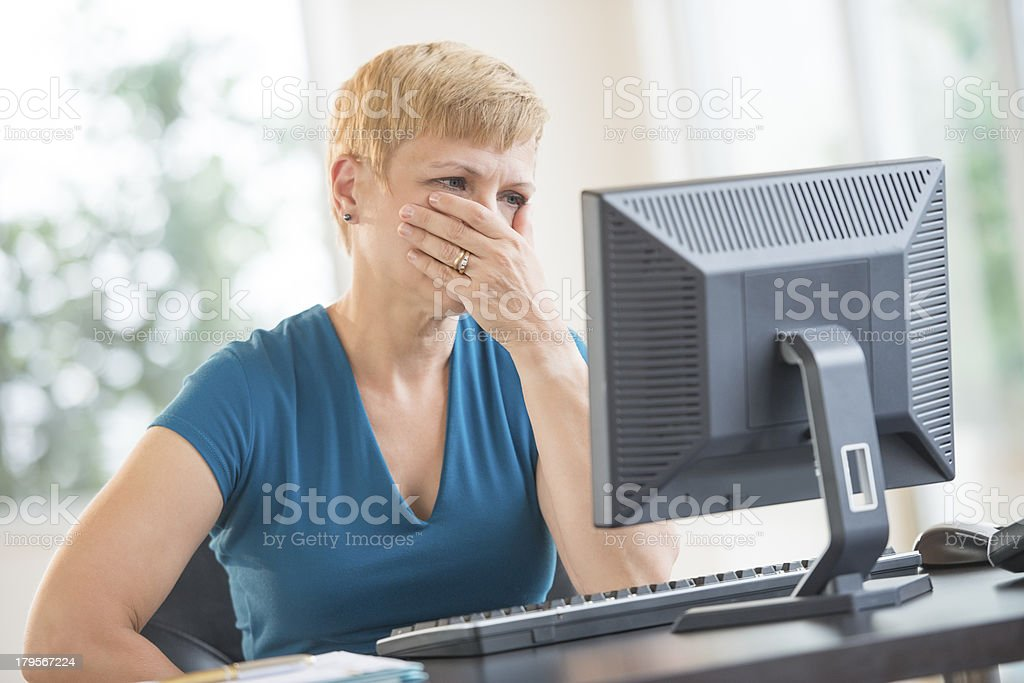Serious Businesswoman Working On Computer stock photo