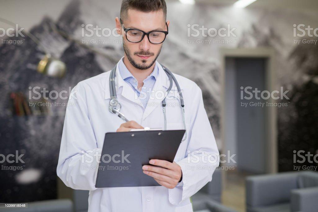 Busy medical specialist examining data