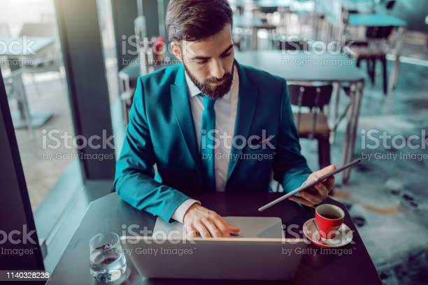 Serious caucasian bearded businessman in suit using tablet and laptop picture id1140328238?b=1&k=6&m=1140328238&s=612x612&h=ylwr9btpglwoq5rbtksz9gtvoe4dxarpeo7pce4gohs=