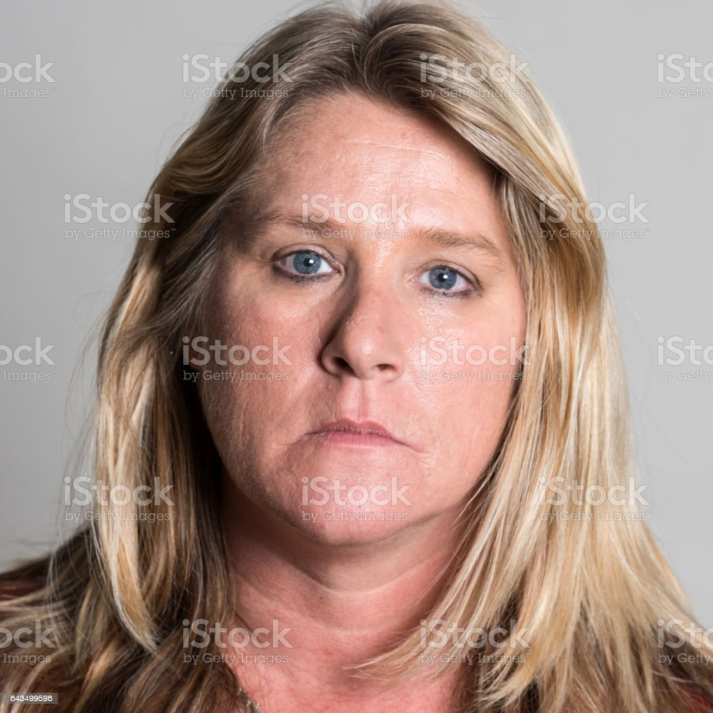 Serious caucasian mature woman stock photo