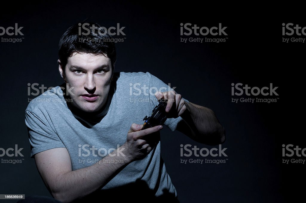 Serious Caucasian Young Man Playing Video Games stock photo