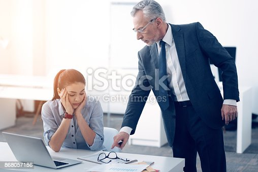 463813207 istock photo Serious chief yelling at female office worker 868057186