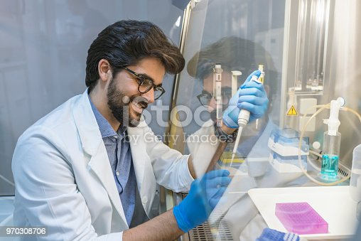517743436 istock photo Serious clinician studying chemical element in laboratory 970308706