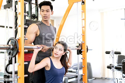 610237160 istock photo Serious coach giving instruction to a female athlete standing on a treadmill in a fitness center 1088890714