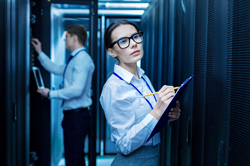 Serious Colleagues Working In The Data Center Stock Photo - Download Image Now