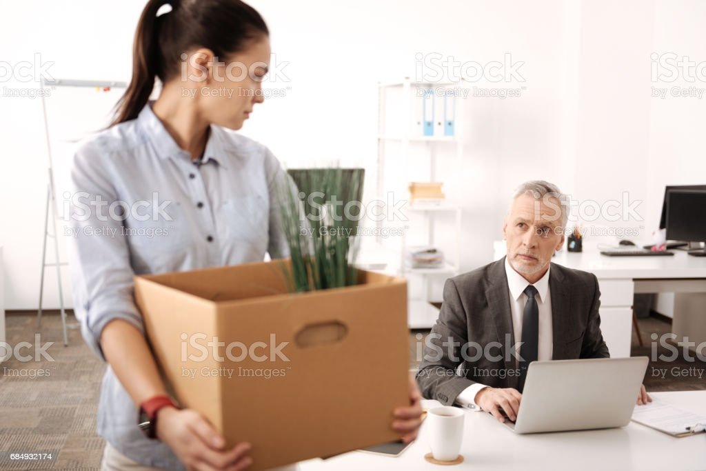 Serious competent businessman working with laptop stock photo