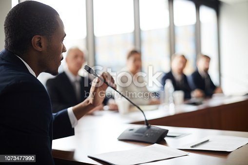 Confident black businessman expressing his viewpoint
