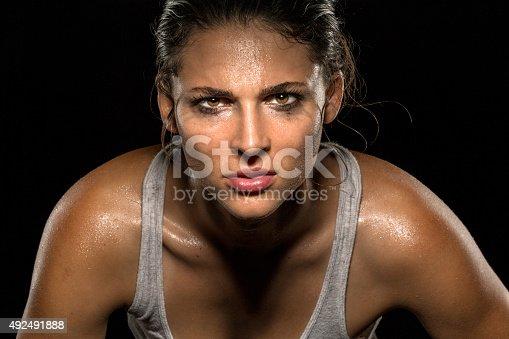 istock Serious confident stare athlete wrestler exercise trainer conviction focused powerful 492491888
