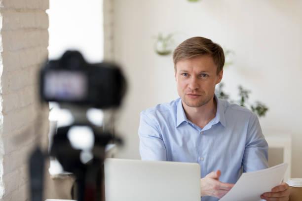 serious confident young professional lecturer recording educational lecture. - dodatkowa praca zdjęcia i obrazy z banku zdjęć