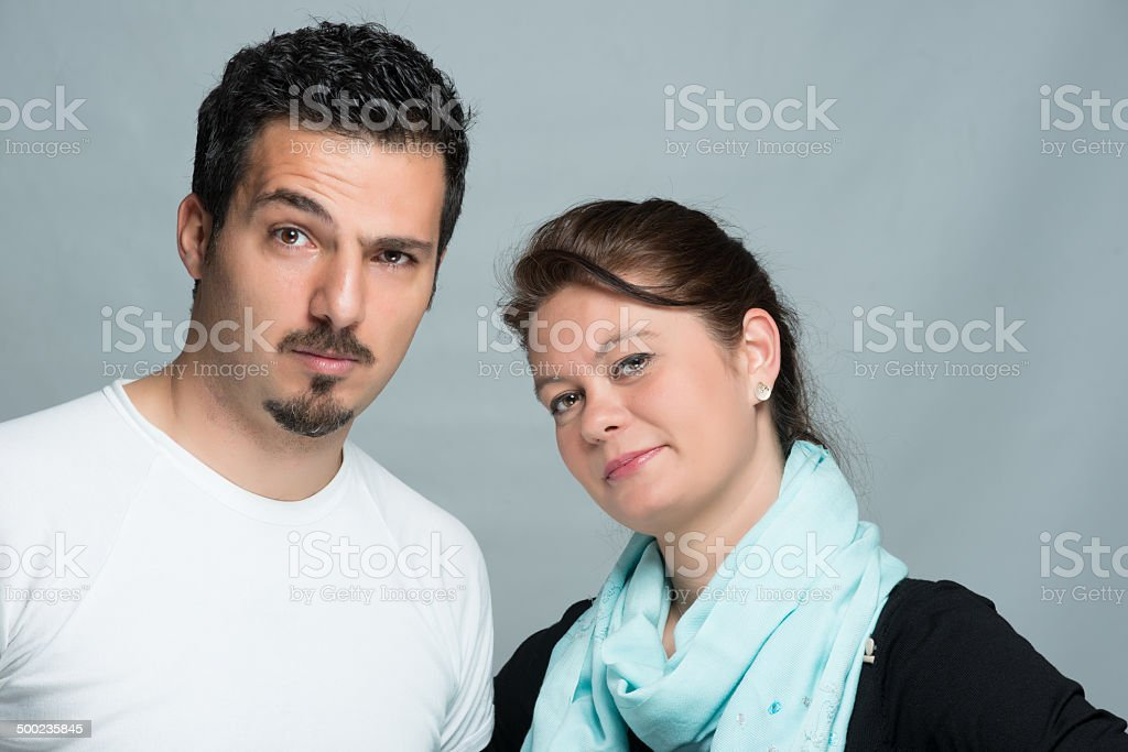 Serious couple posing gray background royalty-free stock photo
