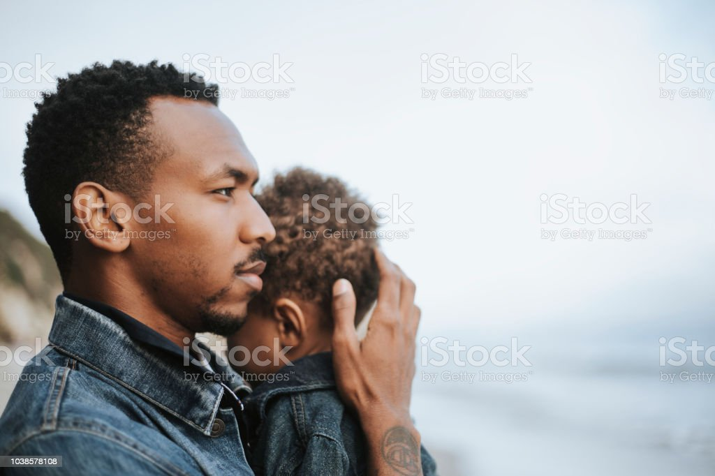 Serious dad with his son outdoors stock photo