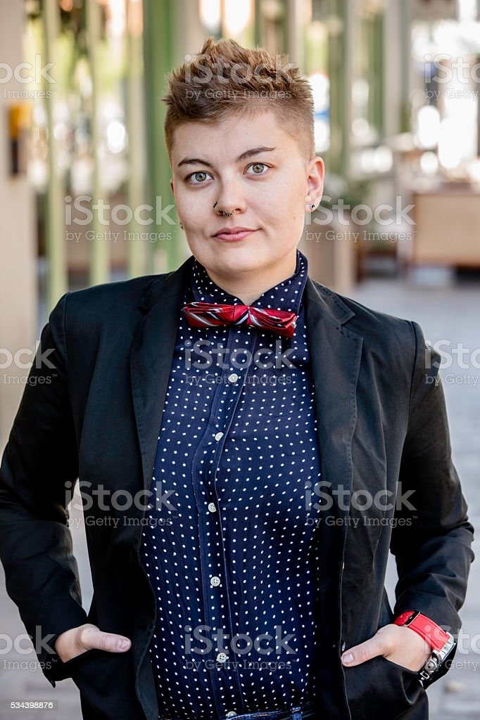 Serious Dapper Gender Fluid Young Woman stock photo