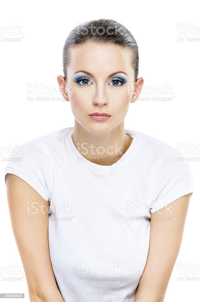 Serious dark-haired woman in white T-shirt royalty-free stock photo