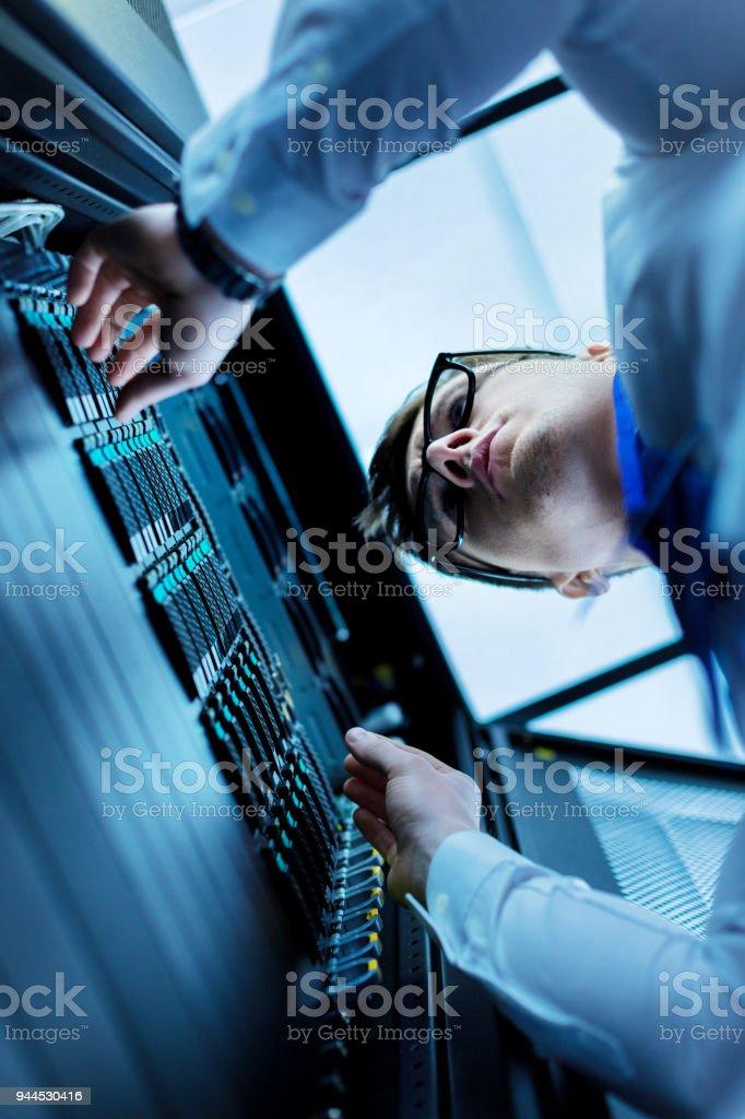 Serious data centre operator working stock photo
