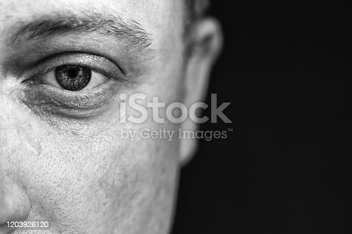 1091817198 istock photo Serious detailed shot of a man on the subject of grief and depression 1203926120