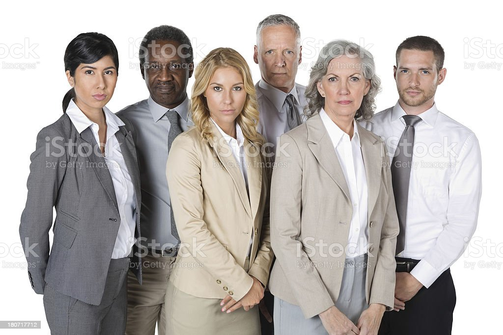Serious diverse business team standing confidently; studio shot royalty-free stock photo